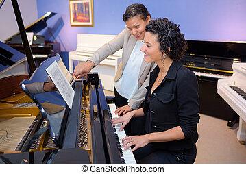 Woman having piano lesson