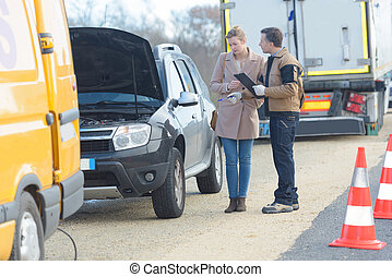 woman having problem with car