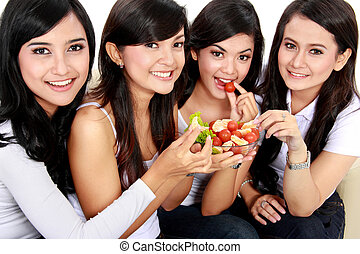 woman having salad together