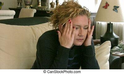 Woman having sinus pain