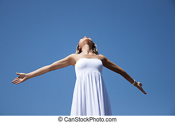 woman having stretched hands aspires in the sky - portrait...