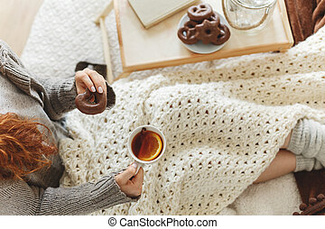 Woman having tea and gingerbread - Woman having a cup of...
