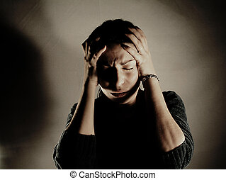 woman having trouble, head covered with hands, emotional expression