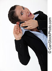 Woman having trouble hearing her interlocutor