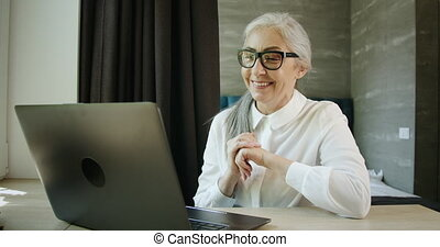 Woman Having Video Chat on Laptop
