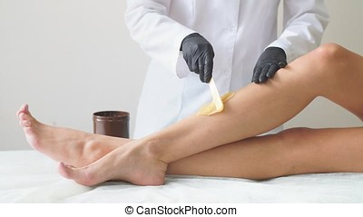 Woman health care leg depilation professional work close-up....