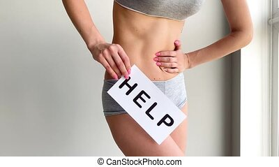 Woman Health. Female Body Holding Symbol Help Card Near Stomach.