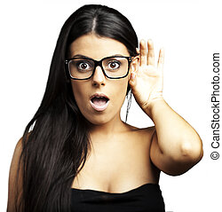 woman hearing - portrait of young woman with glasses hearing...