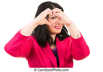 Woman heart made in front of her eye