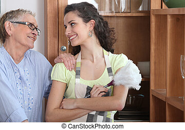 Woman helping mother with the housework