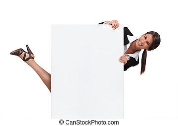 woman hiding behind blank board