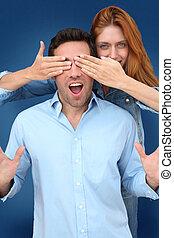 Woman hiding boyfriend's eyes