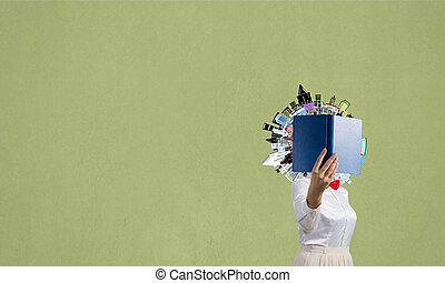 Woman hiding face behind book
