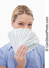 Woman hiding her face behind money