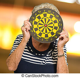 Woman Hiding Her Face With Dart Board