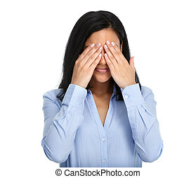 Woman hiding her face with hands.