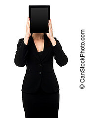 Woman hiding her face with tablet pc