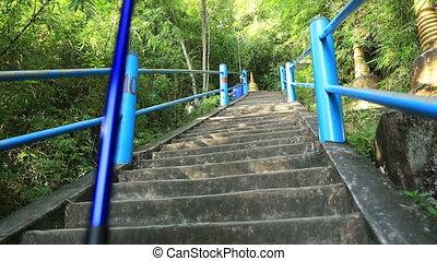 woman hiker climbing stairs - woman hiker climbing stairs at...