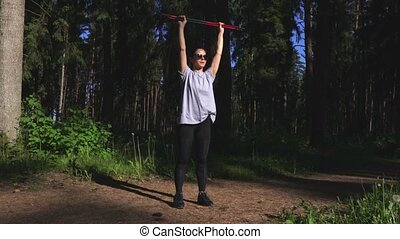 Woman hiker doing exercises with Nordic walking