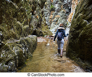 Woman hiker in a canyon