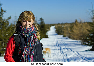 Woman hiker in winter mountains