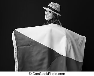 woman hiker isolated on background holding flag of Czech