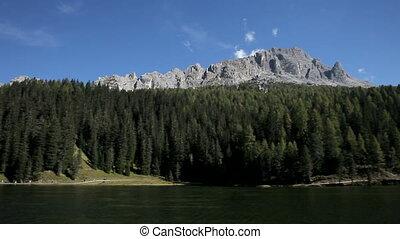 Woman hiker looking mountain - Happy blond woman hiker...