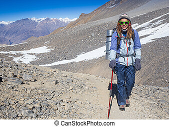 Woman hiker on a top