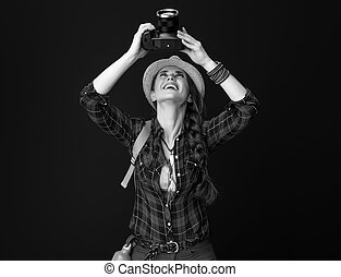 woman hiker on background with DSLR camera taking photo