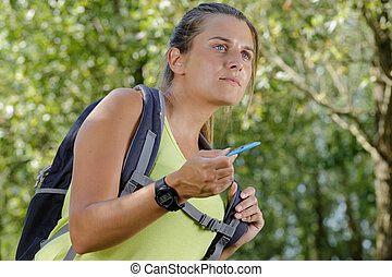 woman hiker on green mountain