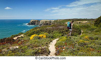 hiker on hiking trail - woman hiker on hiking trail coast...