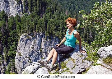 Woman hiker on the mountain peak