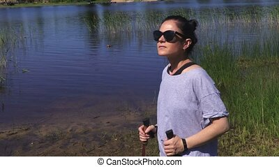 Woman hiker relaxing near lake