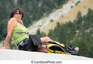 woman hiker sitting on a rock