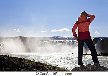 Woman Hiker Standing At Godafoss Waterfall, Iceland
