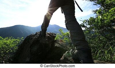 woman hiker sunrise mountain peak - young woman hiker on...