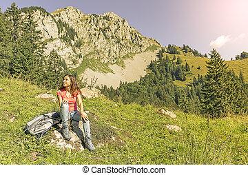 Woman hiker taking a break