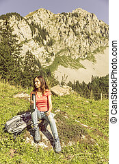 Woman hiker taking a break with a thermos in her hand