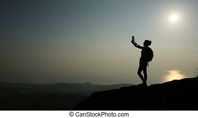 woman hiker taking photo