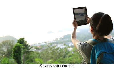 woman hiker use digital tablet