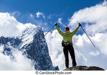 Woman hiker walking in Himalaya Mountains, Nepal - Woman ...