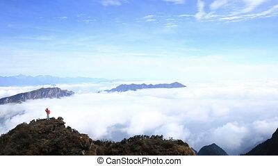 woman hiker walking on mountain top - young woman hiker...