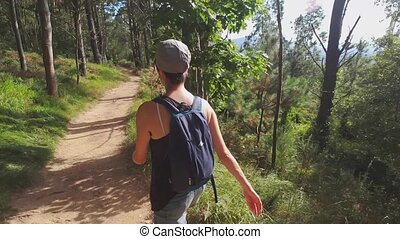 Woman hiker walks on the trail in Pays Basque, Spain