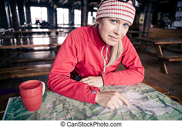 Woman hiker with map planning trip