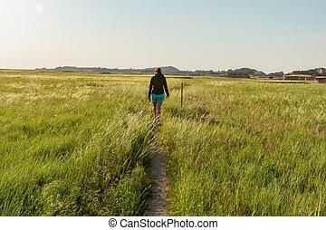 Woman Hikes Through Badlands