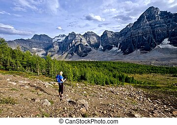 Woman hiking in rocky mountains.