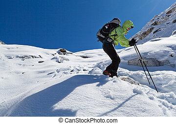 Woman hiking in winter Himalaya Mountains
