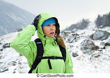 Woman hiking in winter mountains