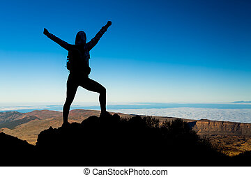 Woman hiking success silhouette, business concept