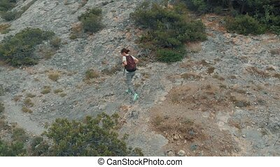 Woman hiking with backpack - Woman traveling with backpack...